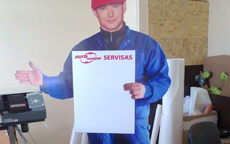 Frezuotas reklaminis stovas iš faneros ir žmogaus atvaizdo lipduko su spauda